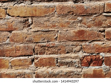 Old brick wall on a hand-made refractory brick.