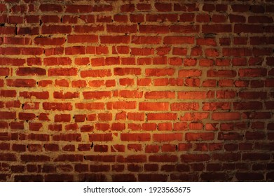 old brick wall in orange and brown colors with a lightened center