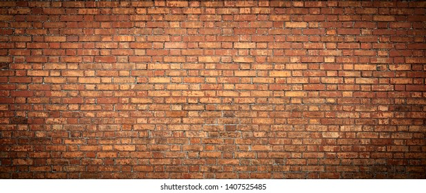 Old Brick wall panoramic view. Grunge red vintage background.