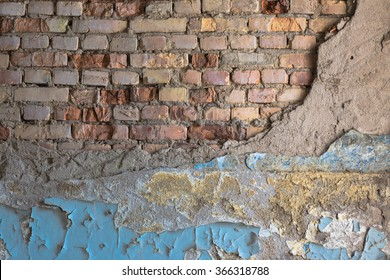 Old brick wall with plaster