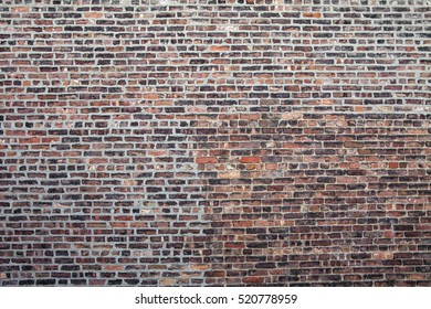 Old Brick wall with repair work