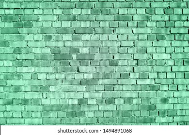 Old Brick Wall Texture In COLOR TREND 2020 Neo mint. Abstract new mint color background. Seafoam Green colored background. Distressed neo mint toned Wall