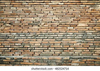 Old brick wall texture grunge background with vignetted corners, may use to interior design.