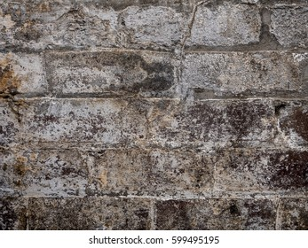 Old brick wall texture painted white deteriorate in the sunlight