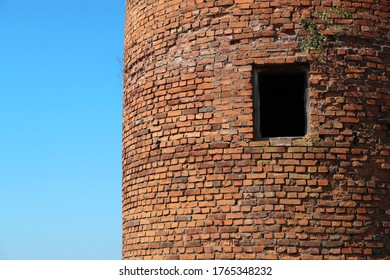 old brick wall with window, old building, round brick building, tower