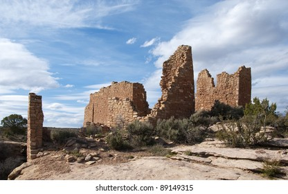 Old brick walls of an ancient Native American structure at Hovenweep National Monument in Utah under a vast partly cloudy sky