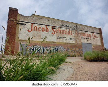 "Old brick warehouse with ""Jacob Schmidt Brewing"" advertisement - landscape color photo"