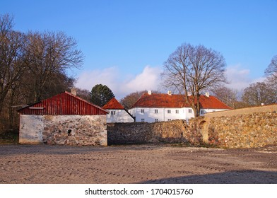 Old brickwall and barn which is a part of a farm on Zealand, Denmark