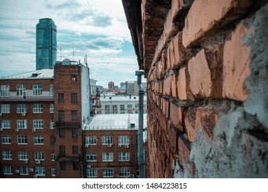 old brickwork on the background of the new city