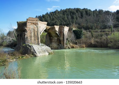Old bridge destroyed in the Tuscan hills.