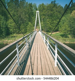 old bridge in forest seen in perspective. central composition - instant vintage square photo