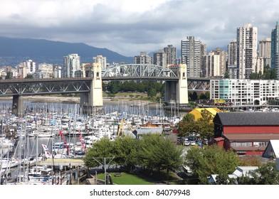 Old bridge & Granville island overlooking a skyline neighborhood in Vancouver BC Canada,