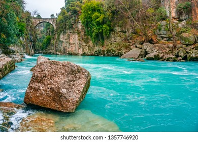 """The old bridge is known as """"Bugrum or Oluk"""" bridge. Koprucay river landscape from Koprulu Canyon National Park in Manavgat, Antalya, Turkey. The Ancient Roman architecture."""