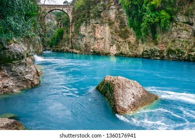 "Old bridge is known as ""Bugrum or Oluk"" bridge. Koprucay river landscape from Koprulu Canyon National Park in Manavgat, Antalya, Turkey. The Ancient Roman architecture."