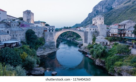 Old Bridge of Mostar across the Neretva River in Bosnia and Herzegovina. Sunrise   The bridge was included in the UNESCO World Heritage List in 2005.