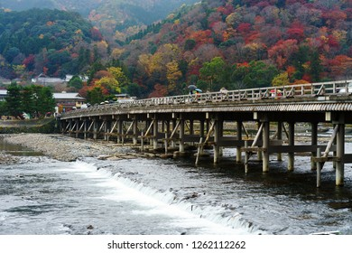 The old bridge named Togetsukyo or Moon Crossing Bridge in english. It is built on Katsura river which located in Arashiyama park. Arashiyama is particularly popular during the fall color season.