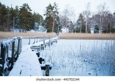 Old bridge over the frozen lake