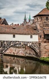 Old bridge over Pegnitz river in Altstadt in Nuremberg, Germany