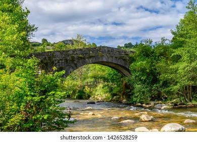 Old bridge over the Rio de las Cabras O Bedon at La Herrería de Vibaño, Asturias, Spain