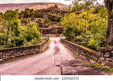 Old bridge over the river Ax-les-thermes near the village with the same name in the French Pyrenees and neighboring Andorra. Ariege France