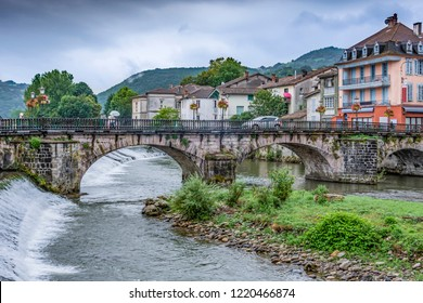 Old bridge over the river Salat in the central part of the old village of Saint Girons. Ariege France