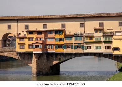 Old bridge Ponte Vecchio at Arno river in Florance