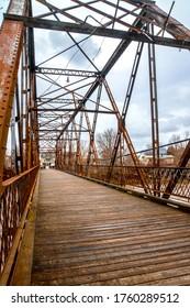 old bridge in rusty metal structure and wooden floor of Saint-Pie, Quebec