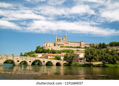 Old bridge and Saint Nazaire cathedral on the Orb river in Beziers, France