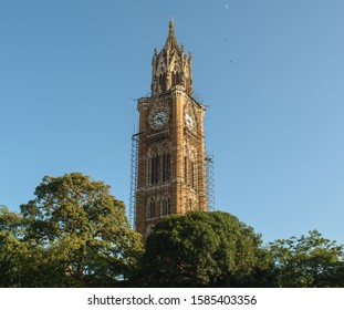 The old, British-era Rajabai Clock Tower in the city of Mumbai with scaffolding around it for restoration and repairs.
