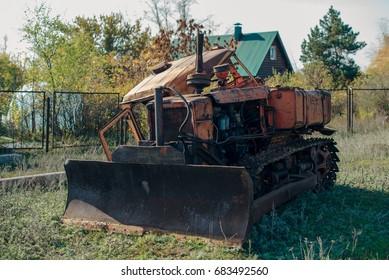 Old broken abandoned tractor
