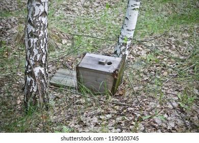 old broken birdhouse lying on the ground, hooligans broke a birdhouse, Russian hooligans