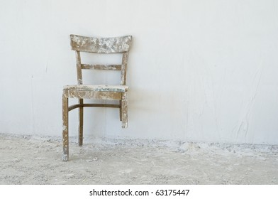 Old broken chair at a construction site