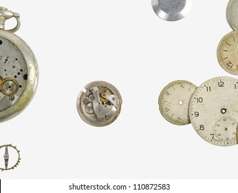 old broken clock parts, on a white background