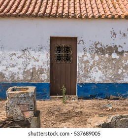An old, broken and closed door in Portugal