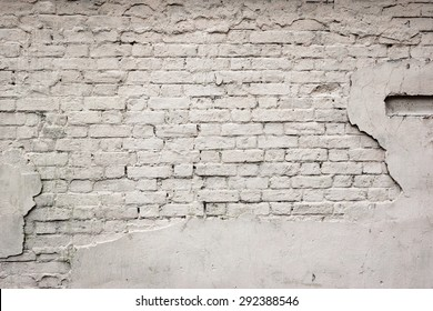 Old Broken Damaged Weathered Plastered Painted White Brick Wall  With Chuckhole Abstract Isolated Background Texture