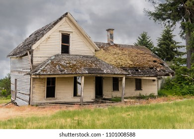 Old Broken, Decaying, Dilapidated Wooden House with Windows, Door and Porch.