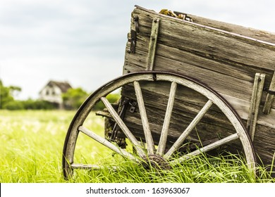 An old broken down wagon abandoned in the field