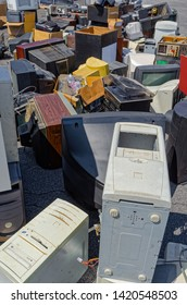 Old and broken electronic equipment is wating outside for recycle pickup.