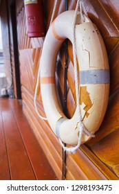 Old, Broken and Expired Personal life support flotation safety device (life buoy) for swimmers, passengers or marine personnel working on boat or area exposed to water. Drowning Protection Equipment.