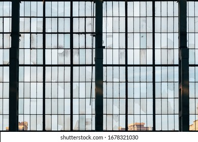 Old broken glass windows at abandoned factory