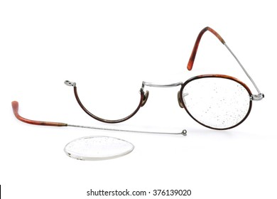old broken glasses isolated on white background