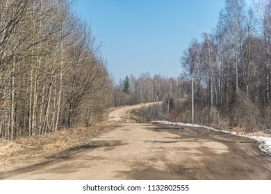 Old broken road with smooth turn