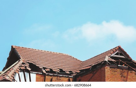 old broken roof and sky background