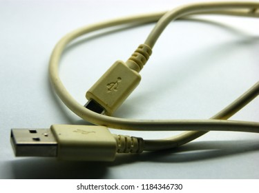 old and broken used usb cable for digital data transfer isolated on grey background
