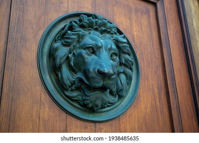 Old bronze door knocker with lion head