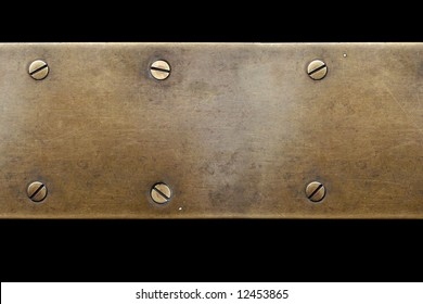 old bronze plate with screw on black background