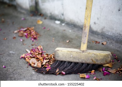 Old broom and flowers