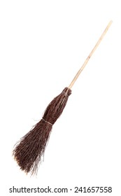 Old broom isolated on white. Witch's broomstick.