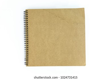 Old brown blank note book on white background