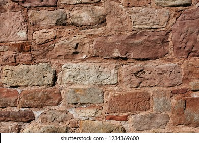 Old brown colors stone wall background texture.Castle fortification ruins.